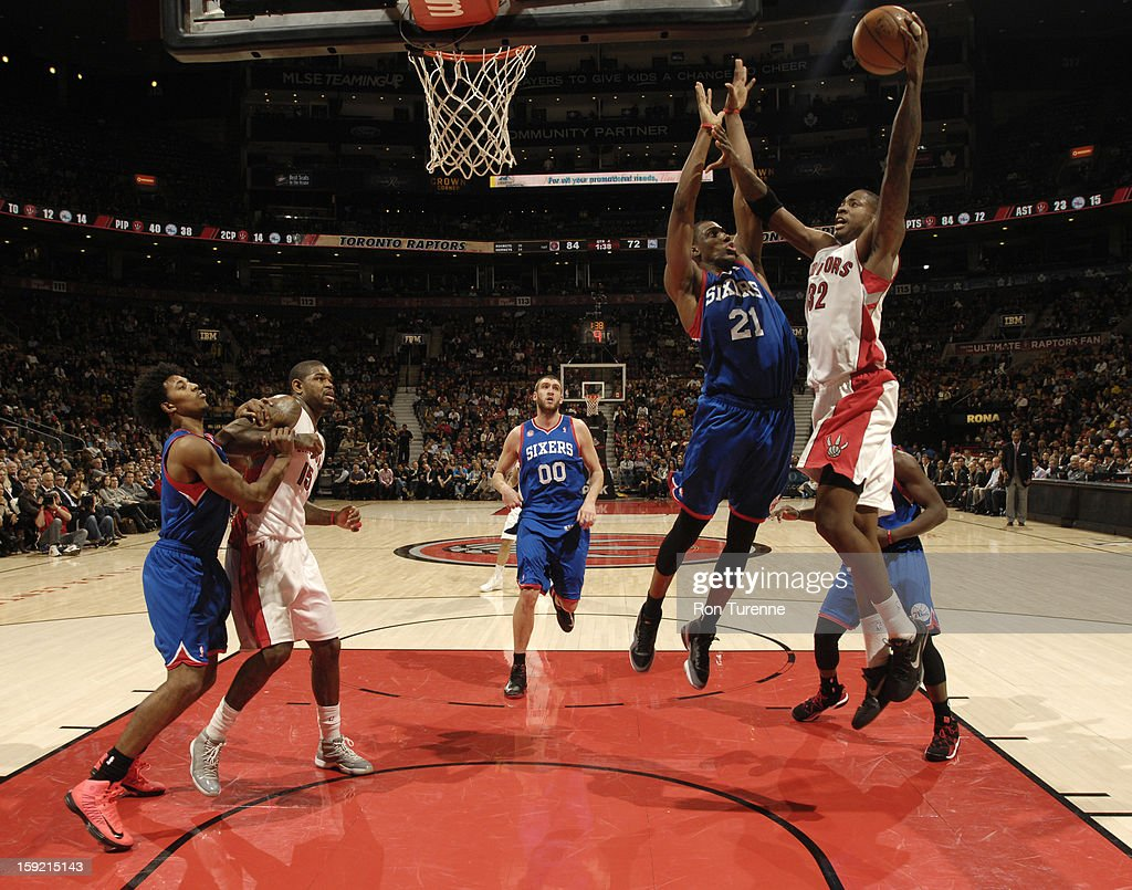 Ed Davis #32 of the Toronto Raptors goes up for the shot against <a gi-track='captionPersonalityLinkClicked' href=/galleries/search?phrase=Thaddeus+Young&family=editorial&specificpeople=3847270 ng-click='$event.stopPropagation()'>Thaddeus Young</a> #21 of Philadelphia 76ers during the game on January 9, 2013 at the Air Canada Centre in Toronto, Ontario, Canada.