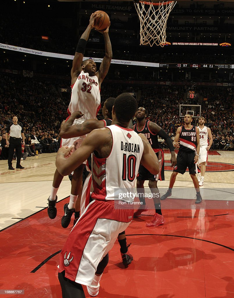 Ed Davis #32 of the Toronto Raptors grabs the ball in mid air against the Portland Trail Blazers during the game on January 2, 2013 at the Air Canada Centre in Toronto, Ontario, Canada.