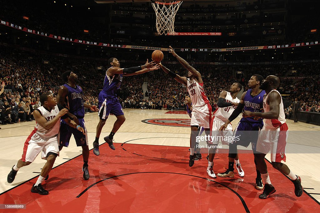 Ed Davis #32 of the Toronto Raptors grabs the ball in mid-air against the Sacramento Kings during the game on January 4, 2013 at the Air Canada Centre in Toronto, Ontario, Canada.
