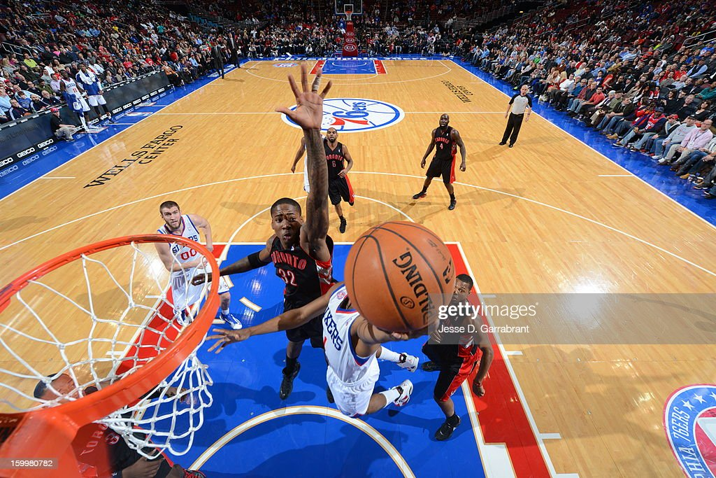 Ed Davis #32 of the Toronto Raptors looks to block the shot of Nick Young #1 of the Philadelphia 76ers at the Wells Fargo Center on January 18, 2013 in Philadelphia, Pennsylvania.