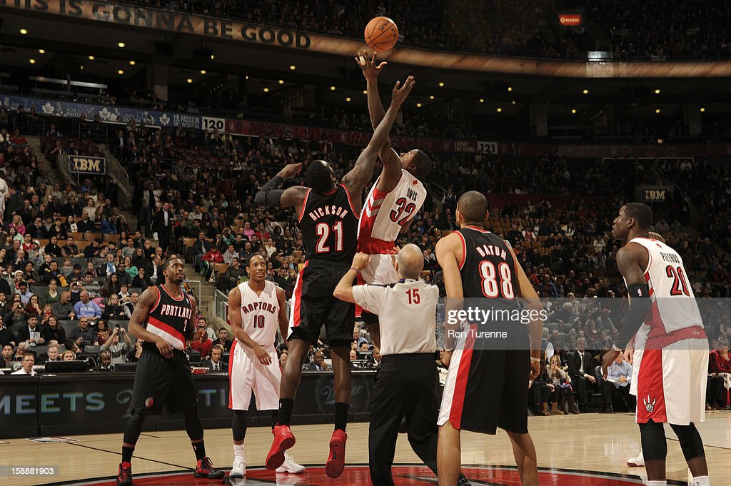 Ed Davis #32 of the Toronto Raptors opens the game up with the tipoff against J.J. Hickson #21 of Portland Trail Blazers during the game on January 2, 2013 at the Air Canada Centre in Toronto, Ontario, Canada.