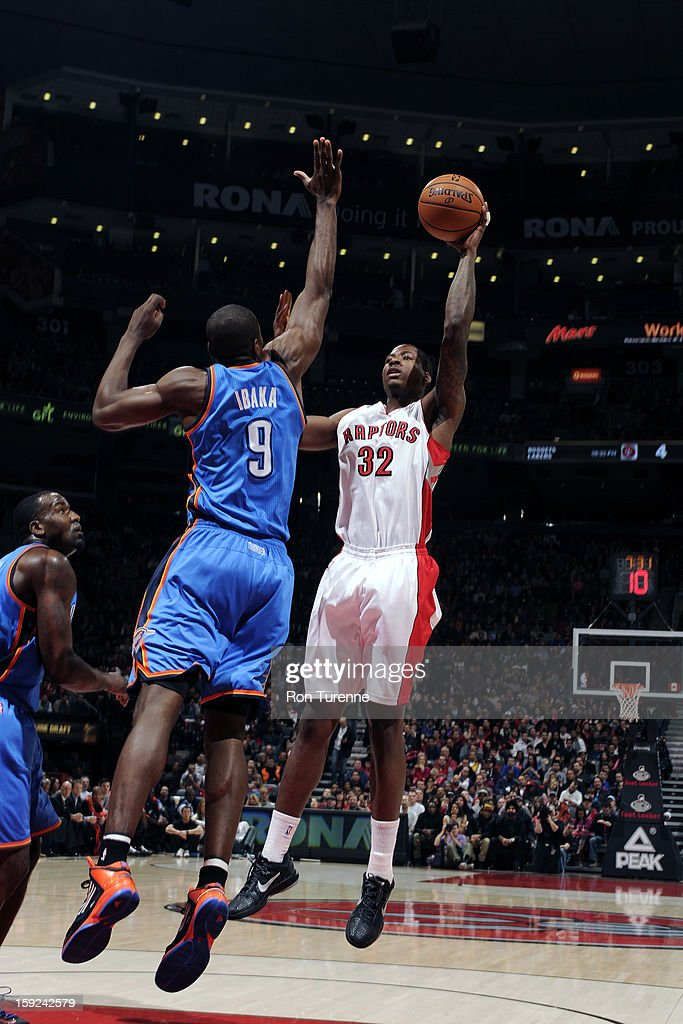 Ed Davis #32 of the Toronto Raptors puts up a shot over <a gi-track='captionPersonalityLinkClicked' href=/galleries/search?phrase=Serge+Ibaka&family=editorial&specificpeople=5133378 ng-click='$event.stopPropagation()'>Serge Ibaka</a> #9 of the Oklahoma City Thunder on January 6, 2013 at the Air Canada Centre in Toronto, Ontario, Canada.