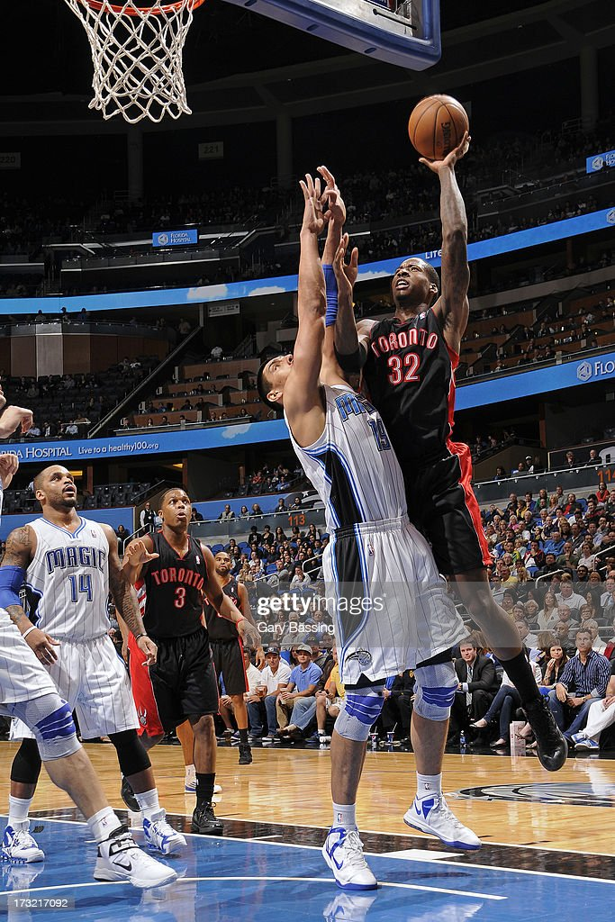 Ed Davis #32 of the Toronto Raptors shoots over Gustavo Ayon #19 of the Orlando Magic during a game on January 24, 2013 at Amway Center in Orlando, Florida.