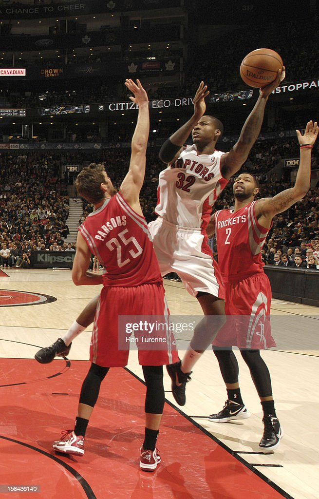 Ed Davis #32 of the Toronto Raptors splits defense of <a gi-track='captionPersonalityLinkClicked' href=/galleries/search?phrase=Chandler+Parsons&family=editorial&specificpeople=4249869 ng-click='$event.stopPropagation()'>Chandler Parsons</a> #25 of the Houston Rockets and Marcus Morris #2 of the Houston Rockets during the game between the Toronto Raptors and the Houston Rockets December 16, 2012 at the Air Canada Centre in Toronto, Ontario, Canada.