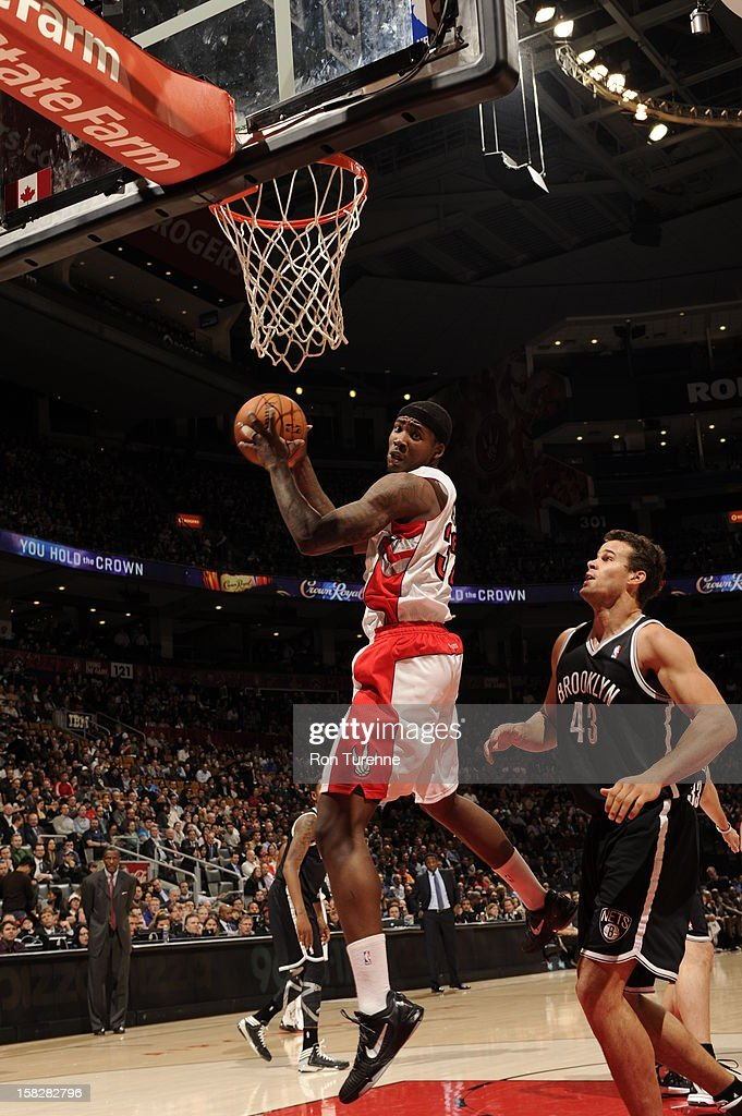 Ed Davis #32 of the Toronto Raptors takes down a rebound against Kris Humphries #43 of the Brooklyn Nets on December 12, 2012 at the Air Canada Centre in Toronto, Ontario, Canada.