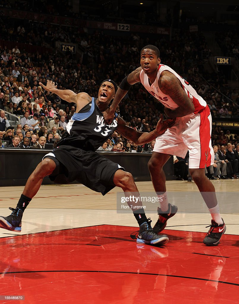 Ed Davis #32 of the Toronto Raptors waits for the ball against <a gi-track='captionPersonalityLinkClicked' href=/galleries/search?phrase=Dante+Cunningham&family=editorial&specificpeople=683729 ng-click='$event.stopPropagation()'>Dante Cunningham</a> #33 of Minnesota Timberwolves during the game on November 4, 2012 at the Air Canada Centre in Toronto, Ontario, Canada.