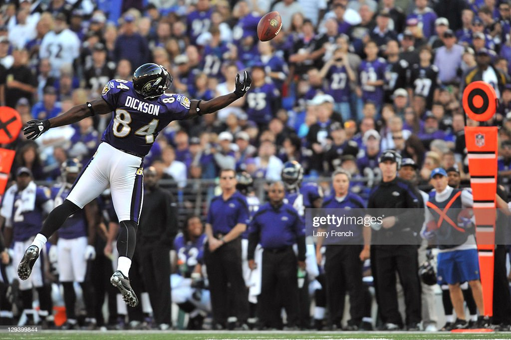 Ed Dickson #84 of the Baltimore Ravens is overthrown on this ball that was intercepted by Jonathan Joseph #24 of the Houston Texans at M&T Bank Stadium on October 16. 2011 in Baltimore, Maryland. The Ravens defeated the Texans 29-14.