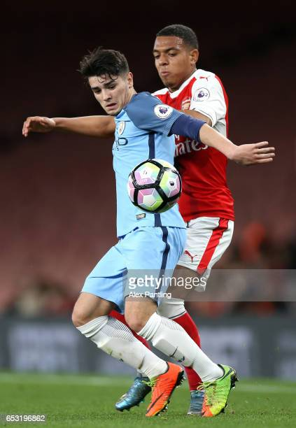 Ed Francis of Manchester City holds off Donyell Malen of Arsenal during the Premier League 2 match between Arsenal and Manchester City at Emirates...