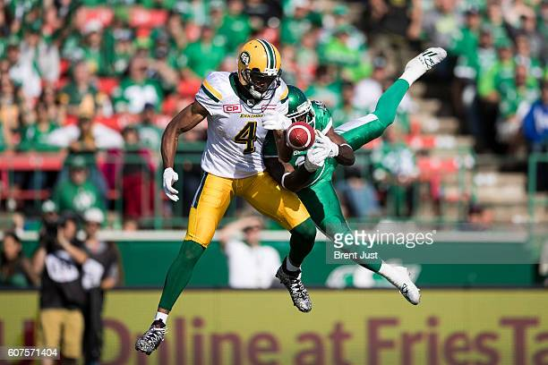 Ed Gainey of the Saskatchewan Roughriders breaks up a pass intended for Adarius Bowman of the Edmonton Eskimos in first half action of the game...