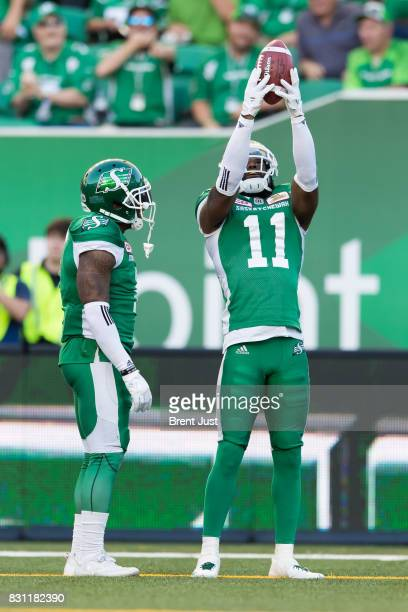 Ed Gainey of the Saskatchewan Roughriders celebrates after his third interception in the first half of the game between the BC Lions and the...