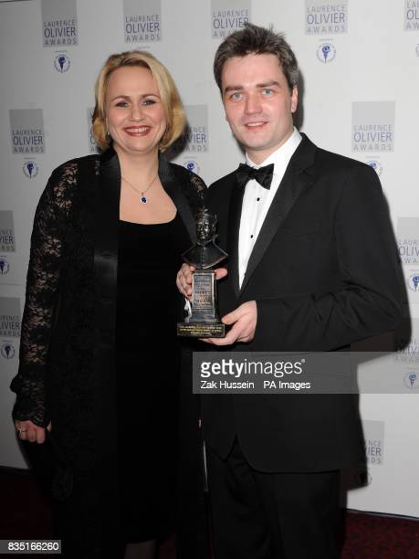 Ed Gardner wins the Outstanding Achievement in Opera Award presented by Anja Kampe during the Laurence Olivier Awards at the Grosvenor Hotel in...