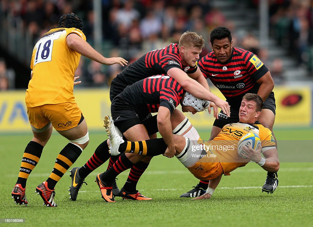 Ed Jackson of London Wasps is tackled during the Aviva Premiership match between Saracens and London Wasps at Allianz Park on October 5, 2013 in Barnet, England.