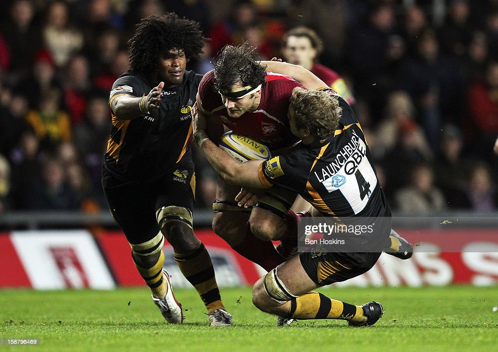 <a gi-track='captionPersonalityLinkClicked' href=/galleries/search?phrase=Ed+Jackson&family=editorial&specificpeople=4629870 ng-click='$event.stopPropagation()'>Ed Jackson</a> of London Welsh is tackled by Joe Launchbury of Wasps (R) during the Aviva Premiership match between London Welsh and London Wasps at the Kassam Stadium on December 29, 2012 in Oxford, England.