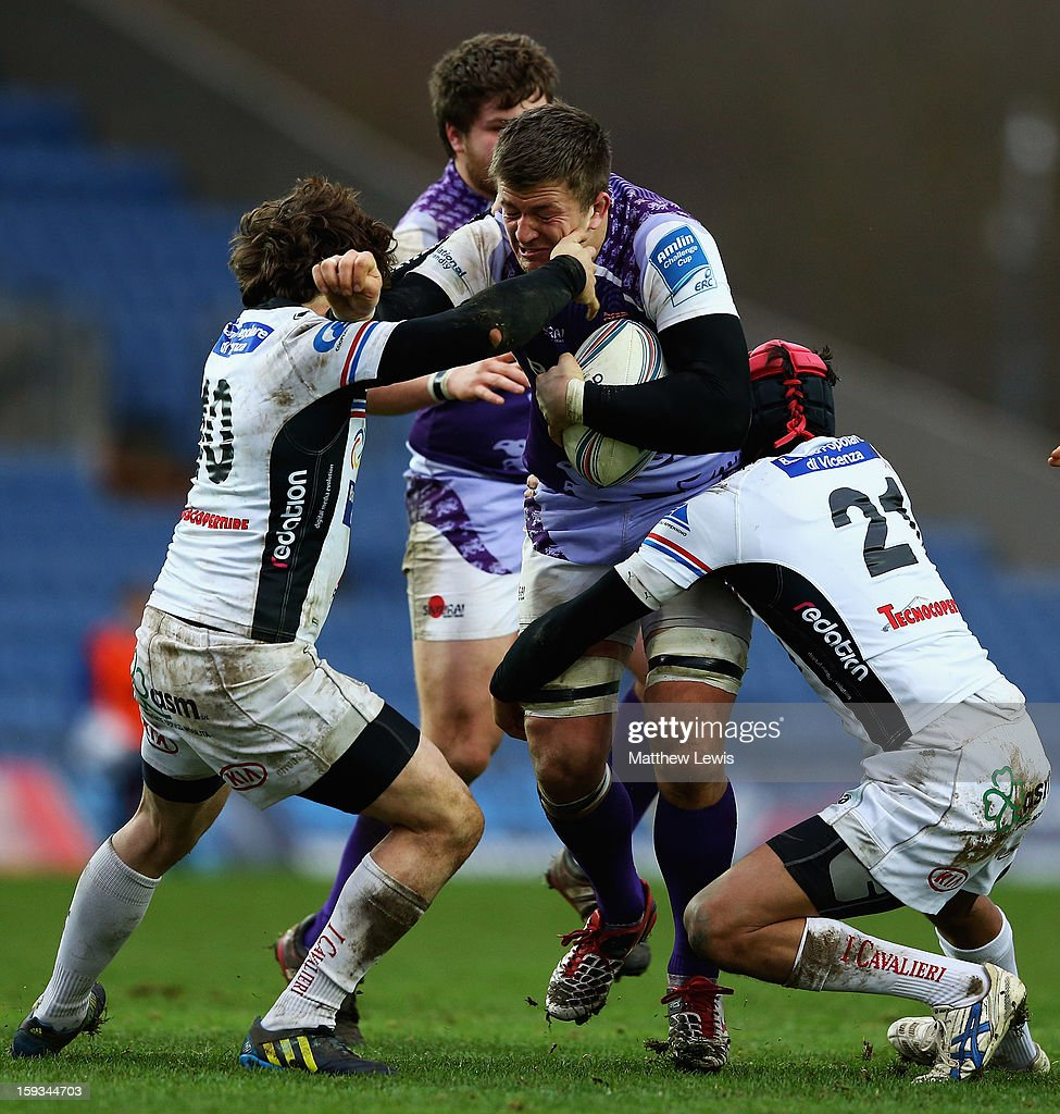 <a gi-track='captionPersonalityLinkClicked' href=/galleries/search?phrase=Ed+Jackson&family=editorial&specificpeople=4629870 ng-click='$event.stopPropagation()'>Ed Jackson</a> of London Welsh is tackled by Simone Ragusi and Ivan Crestini of I Cavalieri Prato during the Amlin Challenge Cup match between London Welsh and I Cavalieri Prato at Kassam Stadium on January 12, 2013 in Oxford, England.