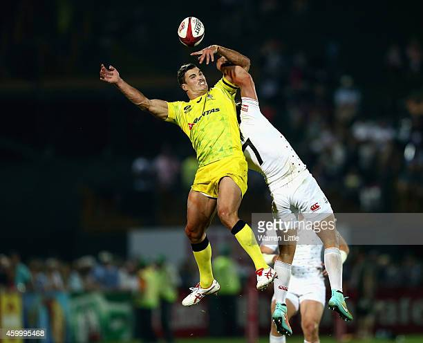 Ed Jenkins of Australia and Dan Bibby of England jump for the ball during day one of the Emirates Dubai Sevens HSBC Sevens World Series on December 5...