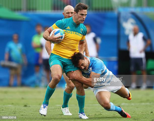Ed Jenkins of Australia is tackled by Juan Imhoff of Argentina during the Men's Rugby Sevens placing 58 match between Argentina and Australia on Day...