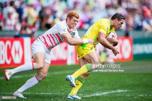 Ed Jenkins of Australia is tackled during the 2017 Hong Kong Sevens match between England and Australia at Hong Kong Stadium on April 8 2017 in Hong...