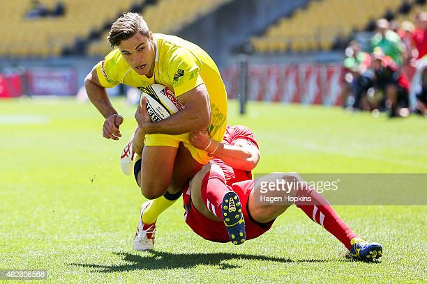 Ed Jenkins of Australia is tackled on his way to scoring a try during the match between Australia and Wales in the 2015 Wellington Sevens at Westpac...