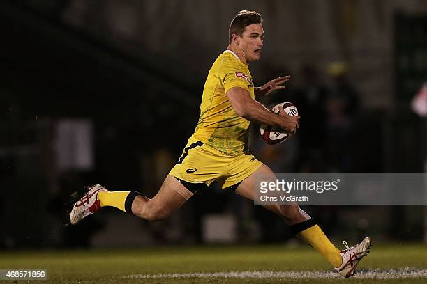 Ed Jenkins of Australia makes a break against New Zealand during the match between New Zealand and Australia on day one of the Tokyo Sevens Rugby...