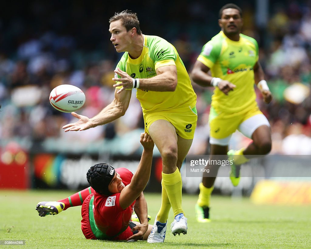 <a gi-track='captionPersonalityLinkClicked' href=/galleries/search?phrase=Ed+Jenkins+-+Rugbyspelare&family=editorial&specificpeople=14322294 ng-click='$event.stopPropagation()'>Ed Jenkins</a> of Australia offloads the ball during the 20146 Sydney Sevens match between Australia and Portugal at Allianz Stadium on February 6, 2016 in Sydney, Australia.