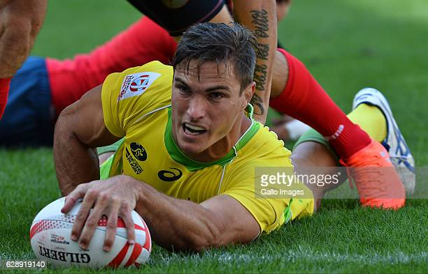 Ed Jenkins of Australia scores a try during day 1 of the HSBC Cape Town Sevens Pool A Australia v Russia match at Cape Town Stadium on December 10...
