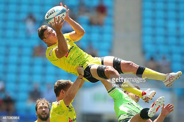 Ed Jenkins of Australia takes a high ball during the 2014 Gold Coast Sevens quarterfinal match between Australia and South Africa at at Cbus Super...