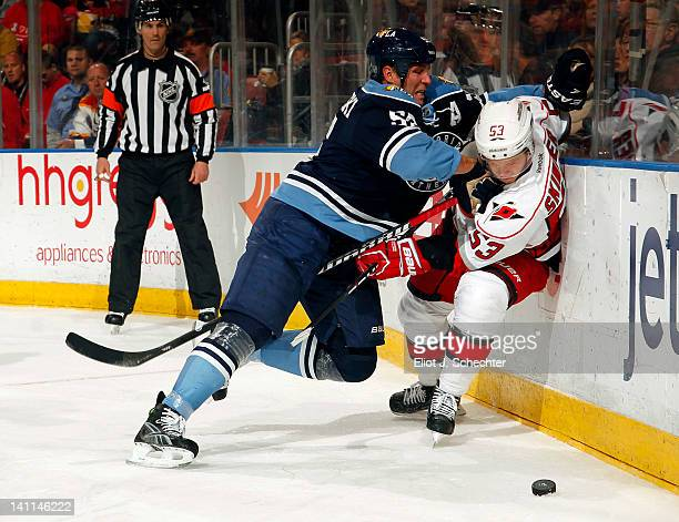 Ed Jovanovski of the Florida Panthers checks Jeff Skinner of the Carolina Hurricanes at the BankAtlantic Center on March 11 2012 in Sunrise Florida