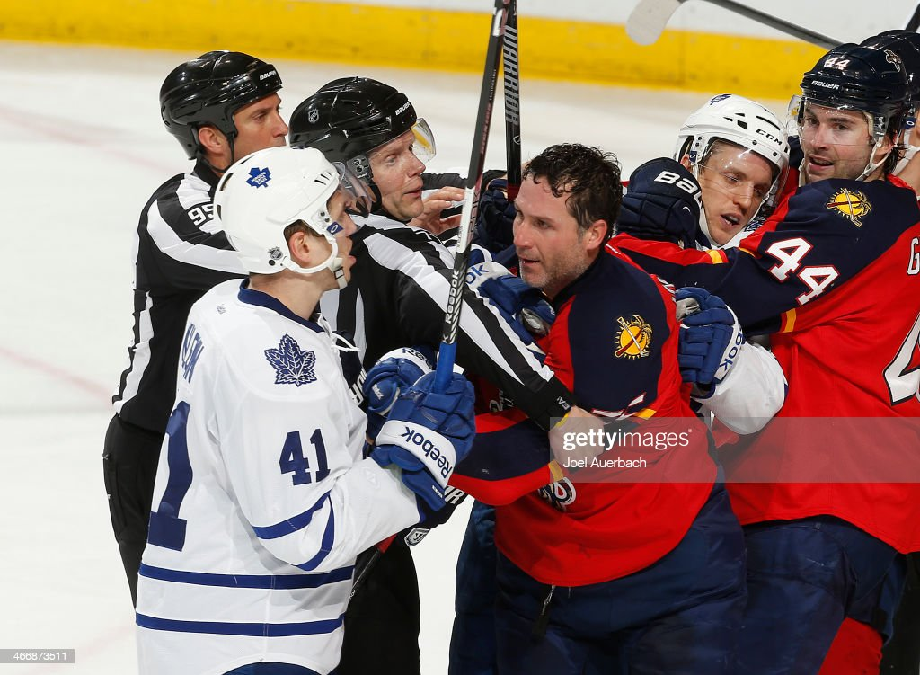Ed Jovanovski #55 of the Florida Panthers is separated from Nikolai Kulemin #41 of the Toronto Maple Leafs during third period action at the BB&T Center on February 4, 2014 in Sunrise, Florida. The Panthers defeated the Maple Leafs 4-1.