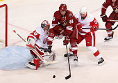 Ed Jovanovski of the Phoenix Coyotes scores a second period goal past goaltender Jimmy Howard of the Detroit Red Wings as Nicklas Lidstrom defends in...