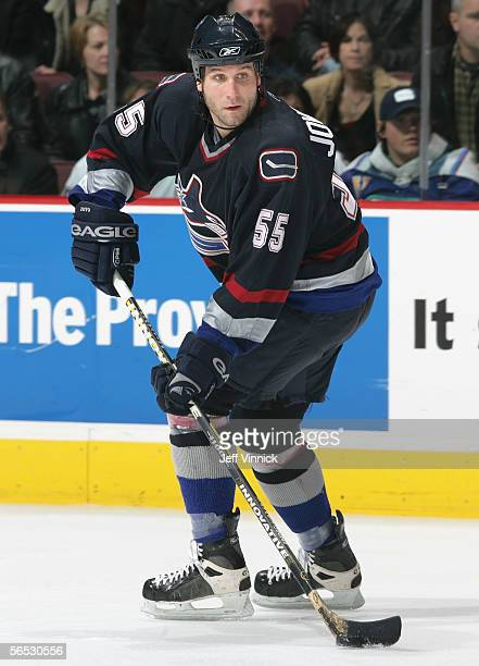 Ed Jovanovski of the Vancouver Canucks skates with the puck against the Edmonton Oilers during the NHL game at General Motors Place on December 21...