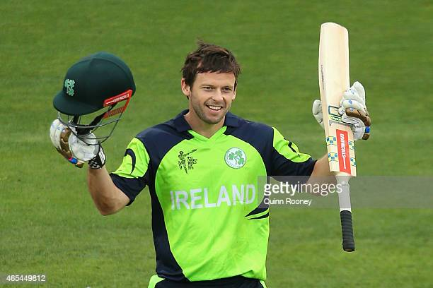 Ed Joyce of Ireland celebrates making his century during the 2015 ICC Cricket World Cup match between Zimbabwe and Ireland at Bellerive Oval on March...