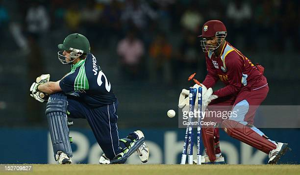 Ed Joyce of Ireland is bowled by Sunil Narine of the West Indies during the ICC World Twenty20 2012 Group B match between the West Indies and Ireland...