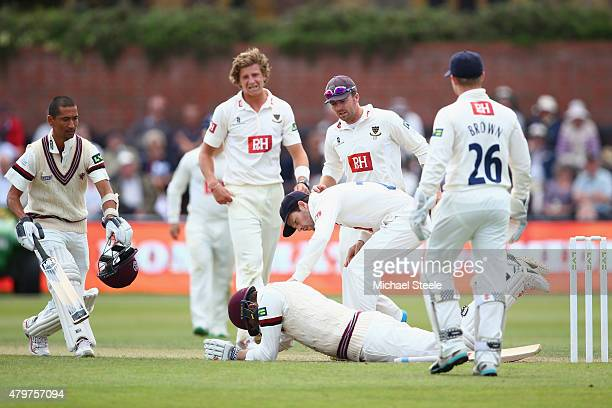 Ed Joyce the captain of Sussex shows his concern as Craig Overton of Somerset lies injured after being hit on the helmet by a delivery from Matthew...