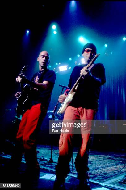 Ed Kowalczyk of Live left performs at the Riviera Theater in Chicago Illinois October 27 1997