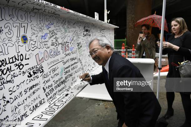 Ed Lee mayor of San Francisco signs the final steel beam during a topping off ceremony for the Salesforce Tower in San Francisco California US on...