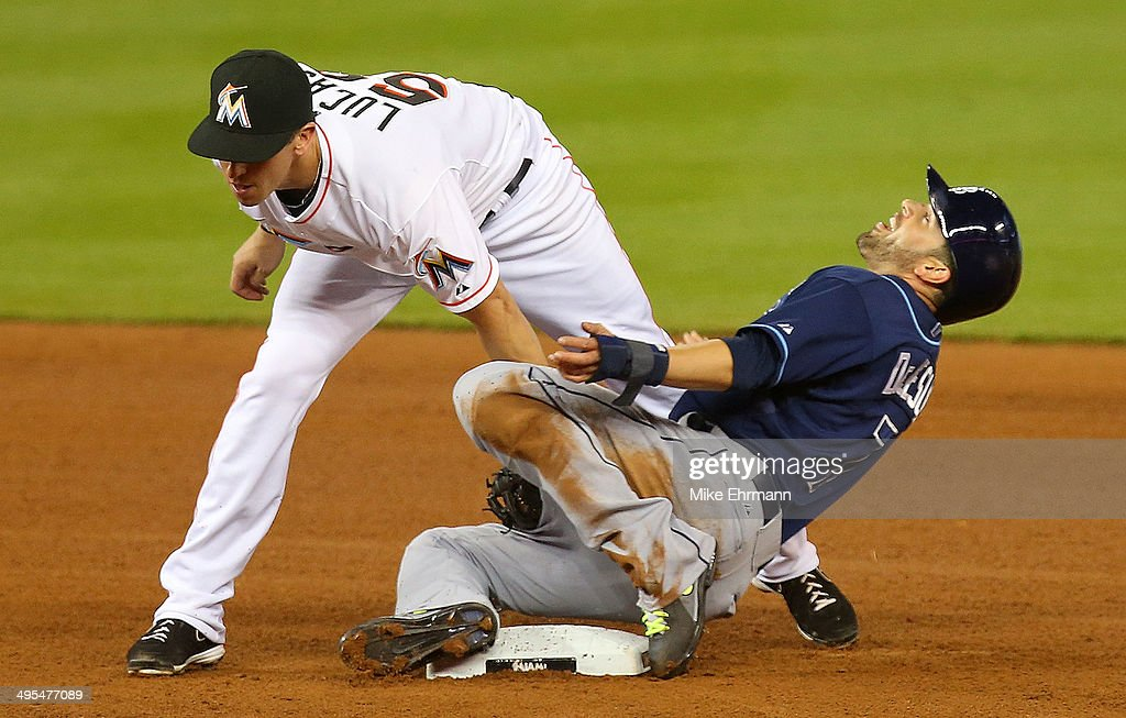 Ed Lucas #59 of the Miami Marlins tags out <a gi-track='captionPersonalityLinkClicked' href=/galleries/search?phrase=David+DeJesus&family=editorial&specificpeople=206765 ng-click='$event.stopPropagation()'>David DeJesus</a> #7 of the Tampa Bay Rays trying to steal during a game at Marlins Park on June 3, 2014 in Miami, Florida.