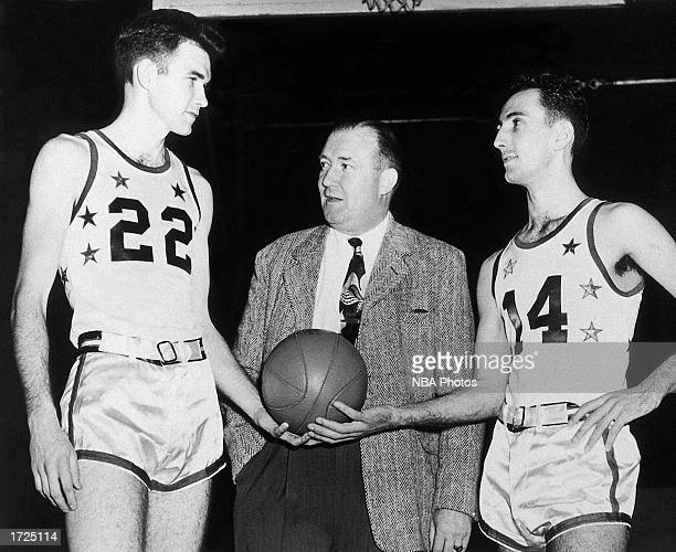 Ed Macauley and Bob Cousy of the Boston Celtics pose with Celtics' owner Walter Brown in 1951 in Boston Massachusetts NOTE TO USER User expressly...