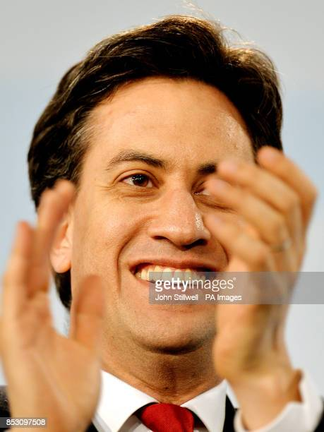 Ed Miliband applauds a speaker at the ExCel Centre in Docklands in east London during a special conference on reforms to the Labour Party