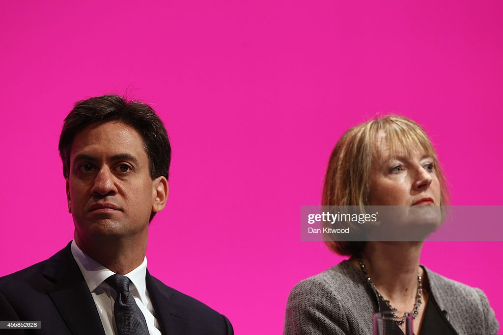 <a gi-track='captionPersonalityLinkClicked' href=/galleries/search?phrase=Ed+Miliband&family=editorial&specificpeople=4376337 ng-click='$event.stopPropagation()'>Ed Miliband</a>, (L) the Leader of the Labour Party and <a gi-track='captionPersonalityLinkClicked' href=/galleries/search?phrase=Harriet+Harman&family=editorial&specificpeople=839866 ng-click='$event.stopPropagation()'>Harriet Harman</a>, Deputy Leader, listen to speaches on stage on day one of the Labour party Conference on September 21, 2014 in Manchester, England. The four-day annual Labour Party Conference officially opens in Manchester today and is expected to attract thousands of delegates with keynote speeches from influential politicians and over 500 fringe events.