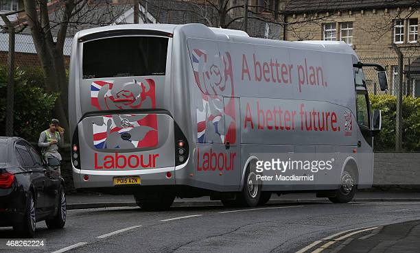 Ed Miliband's election bus leaves a factory after a question and answer session on April 1 2015 in Huddersfield England One Hundred business leaders...