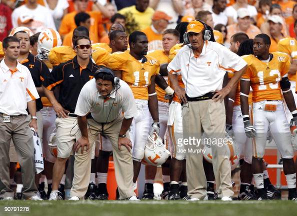 Ed Orgeron assistant head coach and Monte Kiffin defensive coordinator of the Tennessee Volunteers look on against the UCLA Bruins on September 12...