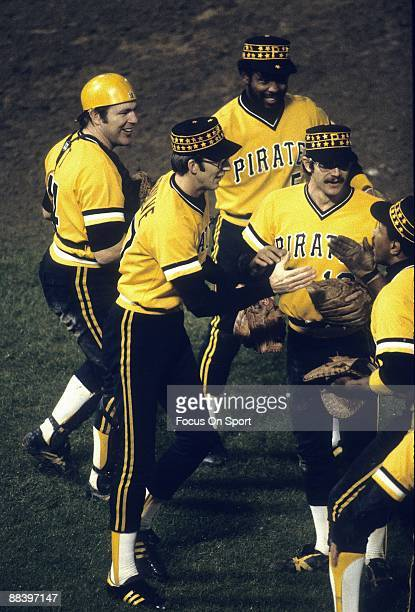Ed Ottfar left Kent Tekulve next Bill Madlock center Tim Foli second from right and Willie Stargell far right of the Pittsburgh Pirates meat on to...