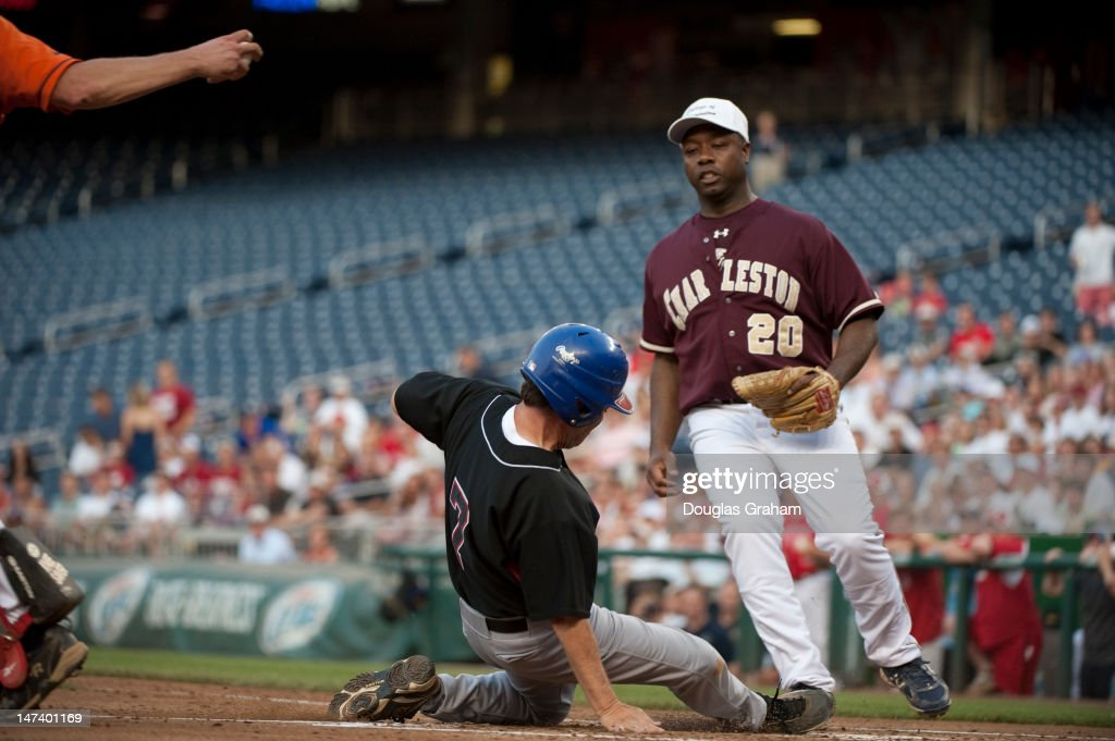 Ed Perlmutter, D-CO., slides into home as Tim Scott, R-SC. covers home plate during the 51st Annual Roll Call Congressional Baseball Game held at Nationals Stadium, June 28, 2012.