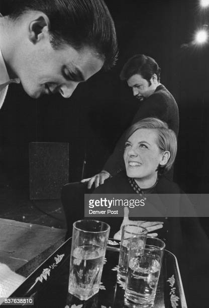 Ed Philipsen serves Eugenie Rearick a drink while Tony Mancinelli a detective watches surreptitiously in 'the Private Eye opening Thursday at the...