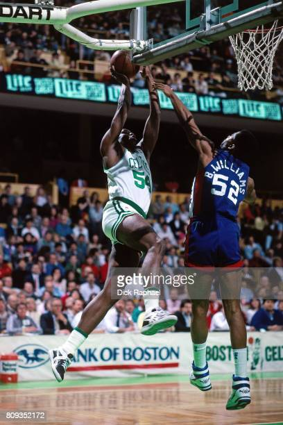 Ed Pinckney of the Boston Celtics drives to the baset against Buck Williams of the New Jersey Nets circa 1989 at the Boston Garden in Boston...