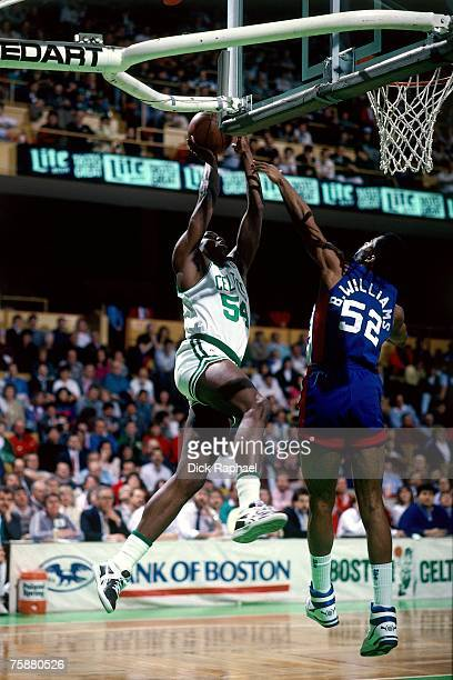 Ed Pinckney of the Boston Celtics drives to the basket against Buck Williams of the New Jersey Nets during an NBA game circa 19881989 at the Boston...