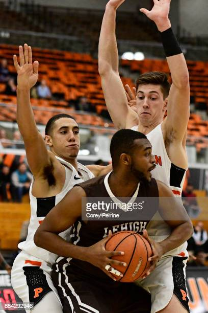 Ed Porter of the Lehigh Mountain Hawks is double teamed by Devin Cannady and Mike LeBlanc of the Princeton Tigers during the second half at L...