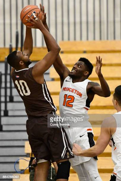 Ed Porter of the Lehigh Mountain Hawks looks to score against Myles Stephens of the Princeton Tigers during the first half at L Stockwell Jadwin...