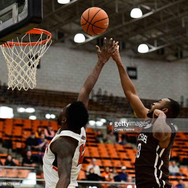 Ed Porter of the Lehigh Mountain Hawks shoots the ball against Myles Stephens of the Princeton Tigers during the second half at L Stockwell Jadwin...