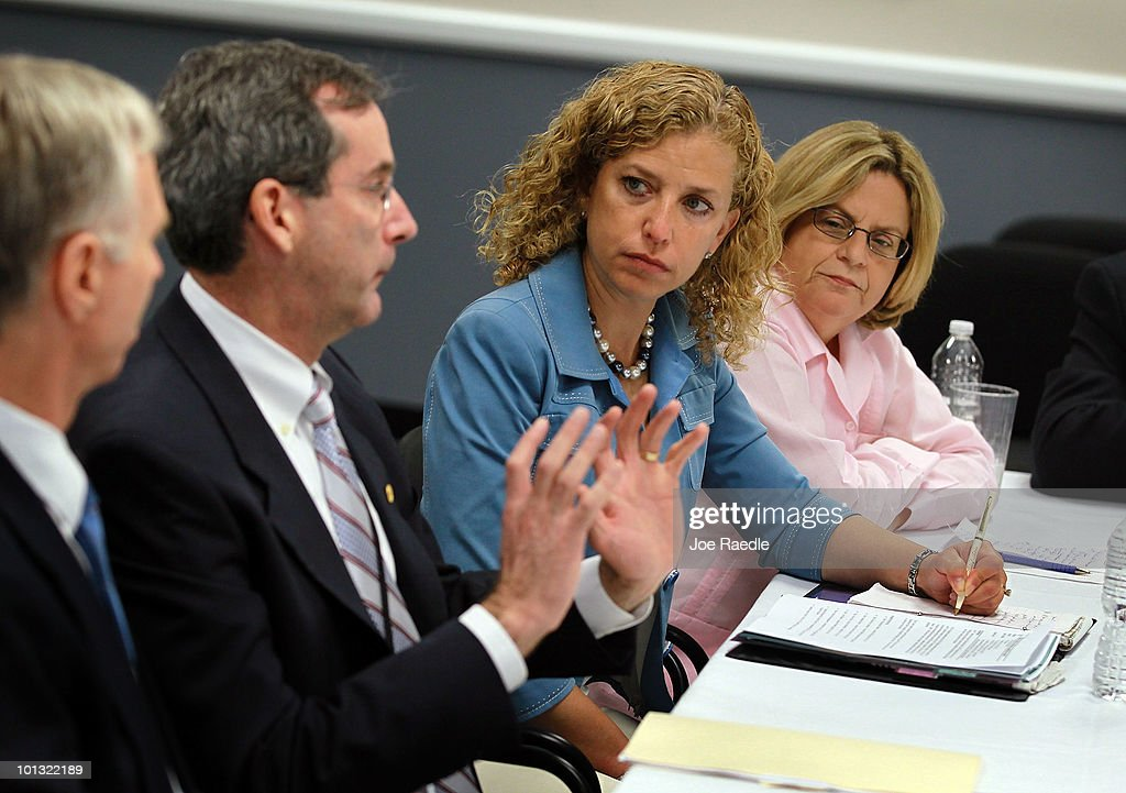 Ed Rappaport, Deputy Director of the National Hurricane Center, Rep. Debbie Wasserman Schultz (D-FL) and Rep. <a gi-track='captionPersonalityLinkClicked' href=/galleries/search?phrase=Ileana+Ros-Lehtinen&family=editorial&specificpeople=588095 ng-click='$event.stopPropagation()'>Ileana Ros-Lehtinen</a> (R-FL) sit together as politicians and officials gathered on the first day of the 2010 Atlantic hurricane season on June 1, 2010 in Opa Locka, Florida. The meeting was conducted to stress the importance of being ready in case a hurricane strikes.